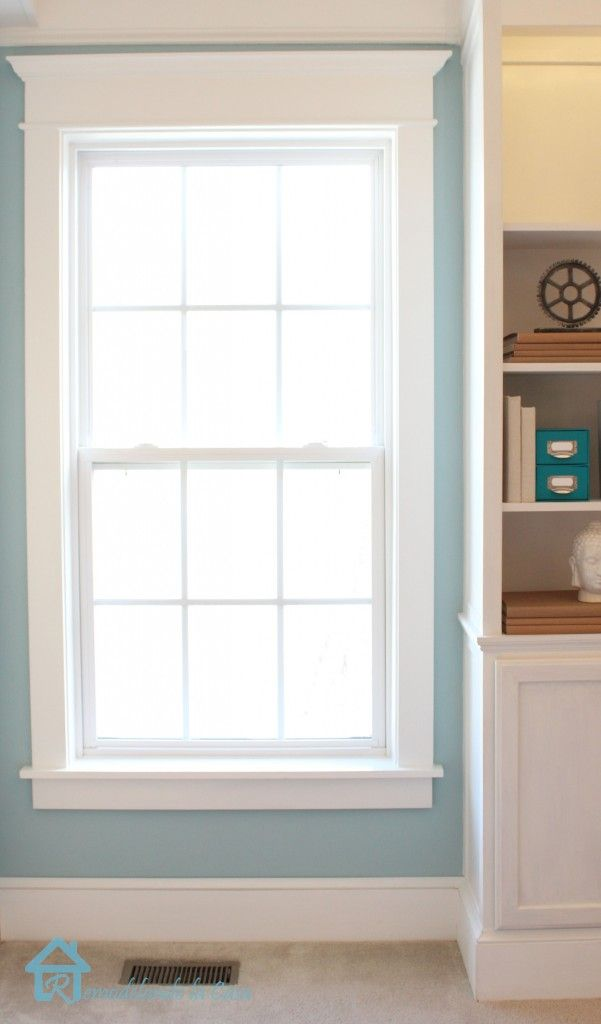 remove fake trim w/rusty nails and put up new trim on window/door, also caulk new trim to finish the look