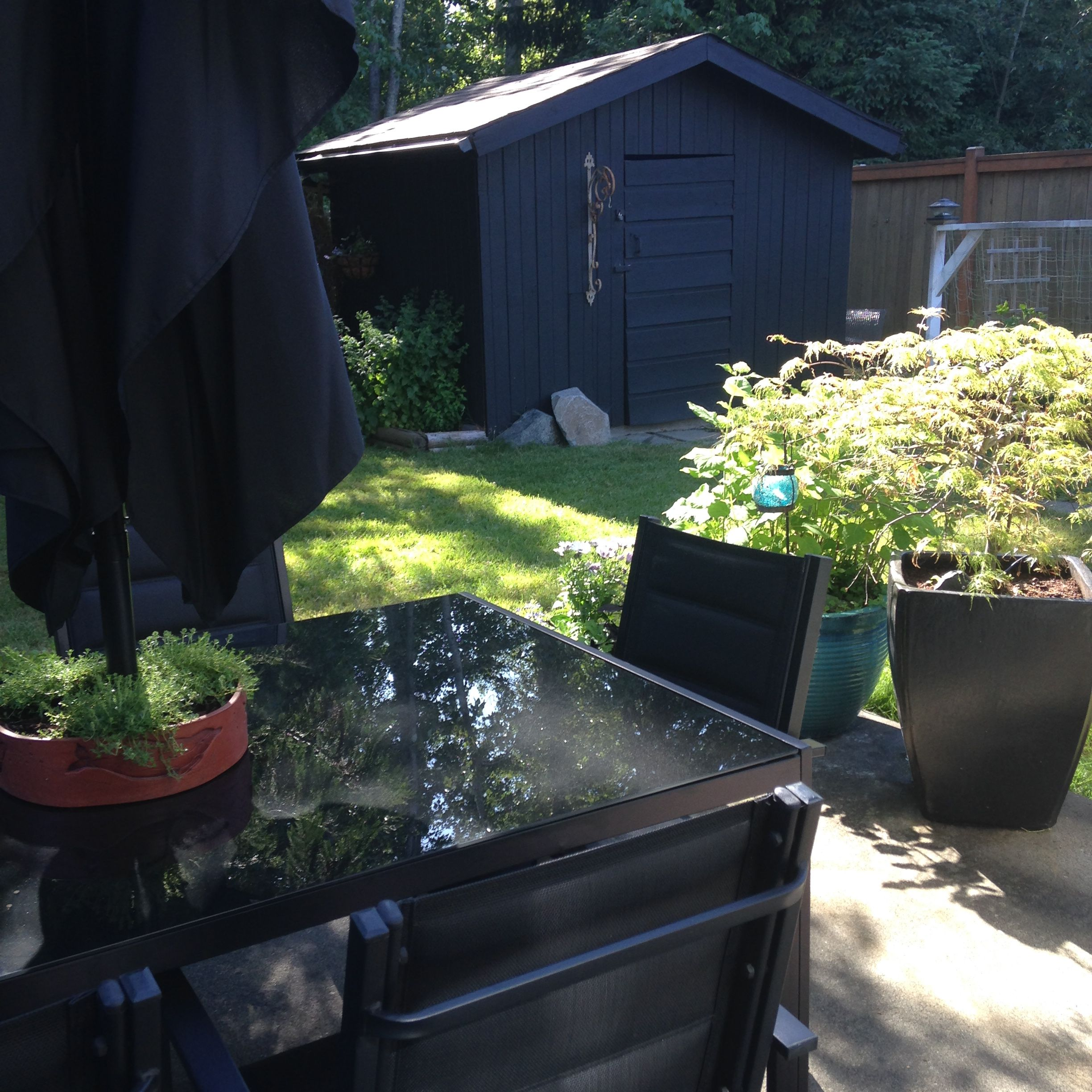 Black outdoor shed, furniture & planters  (Planter available at Coomb's Country Market~ Garden section)