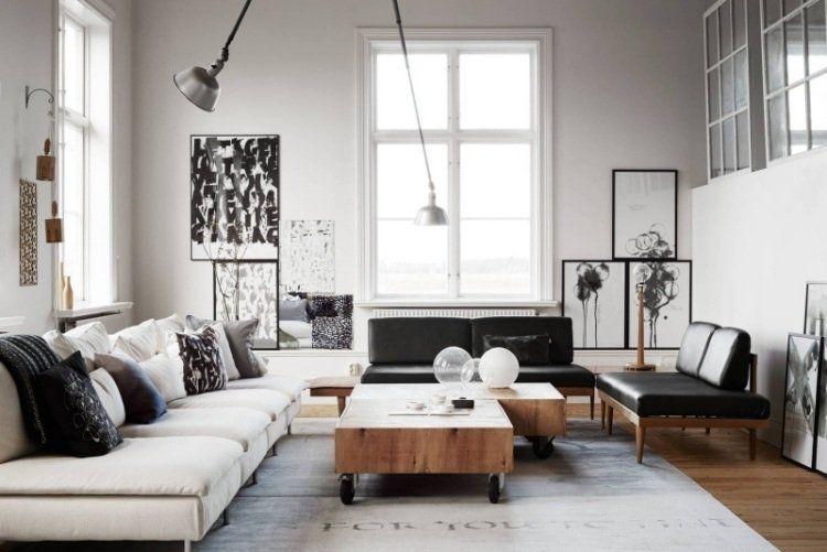 ameublement salon blanc - canapé blanc, table basse en bois massif, tableaux en noir et blanc et coussins décoratifs