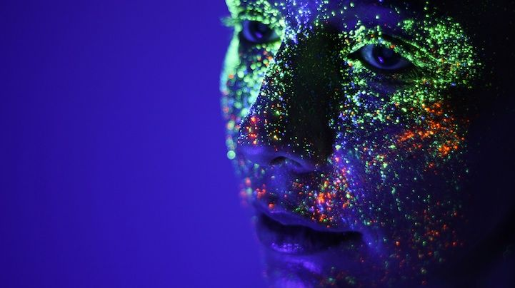 Flecks of vivid neon paint glow brilliantly off faces and shoulders in this series of portraits by Portuguese photographer Hid Saib.