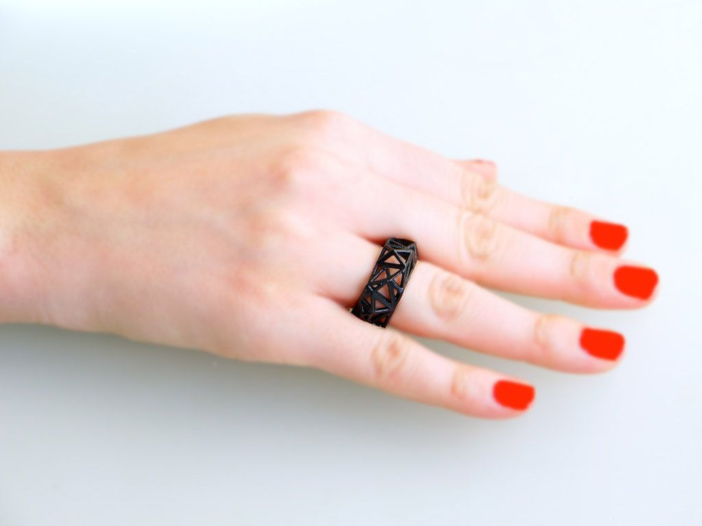 D printed geometric ring triangulated ring in black triangle