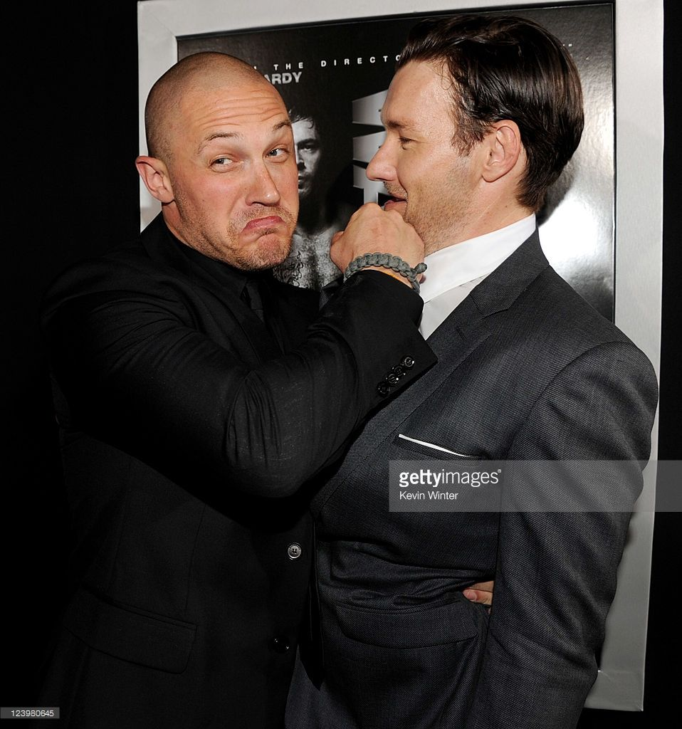 Actors Tom Hardy (L) and Joel Edgerton pose at the premiere of Lionsgate Films' 'Warrior' at the Cinerama Dome Theatre on September 6, 2011 in Los Angeles, California.