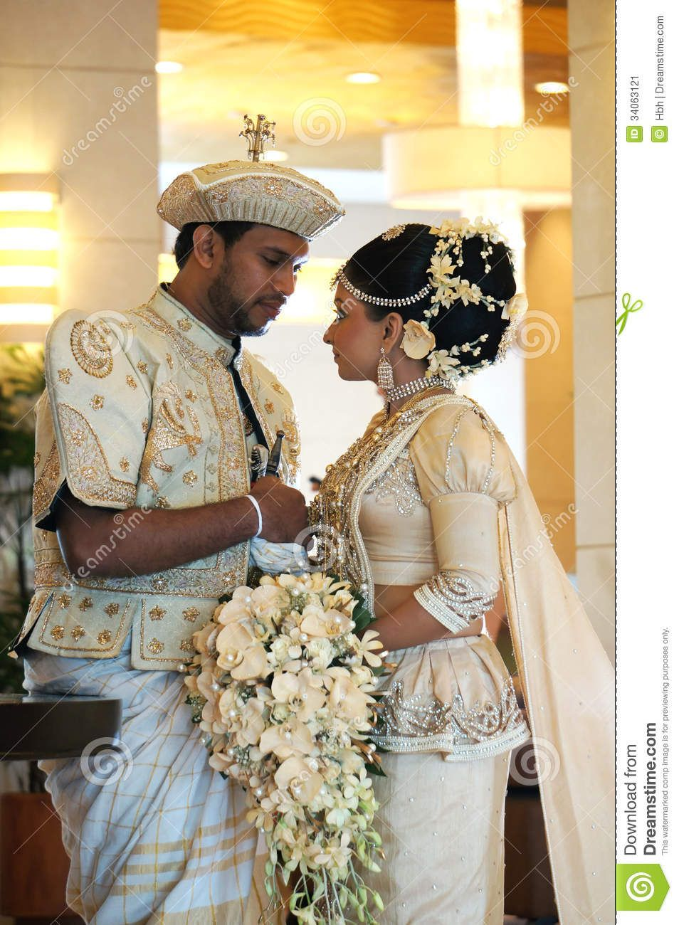 Sri lankan bride and groom with a wedding bouquet in kandy city sri lankan bride and groom with a wedding bouquet in kandy city description from dreamstime izmirmasajfo Image collections