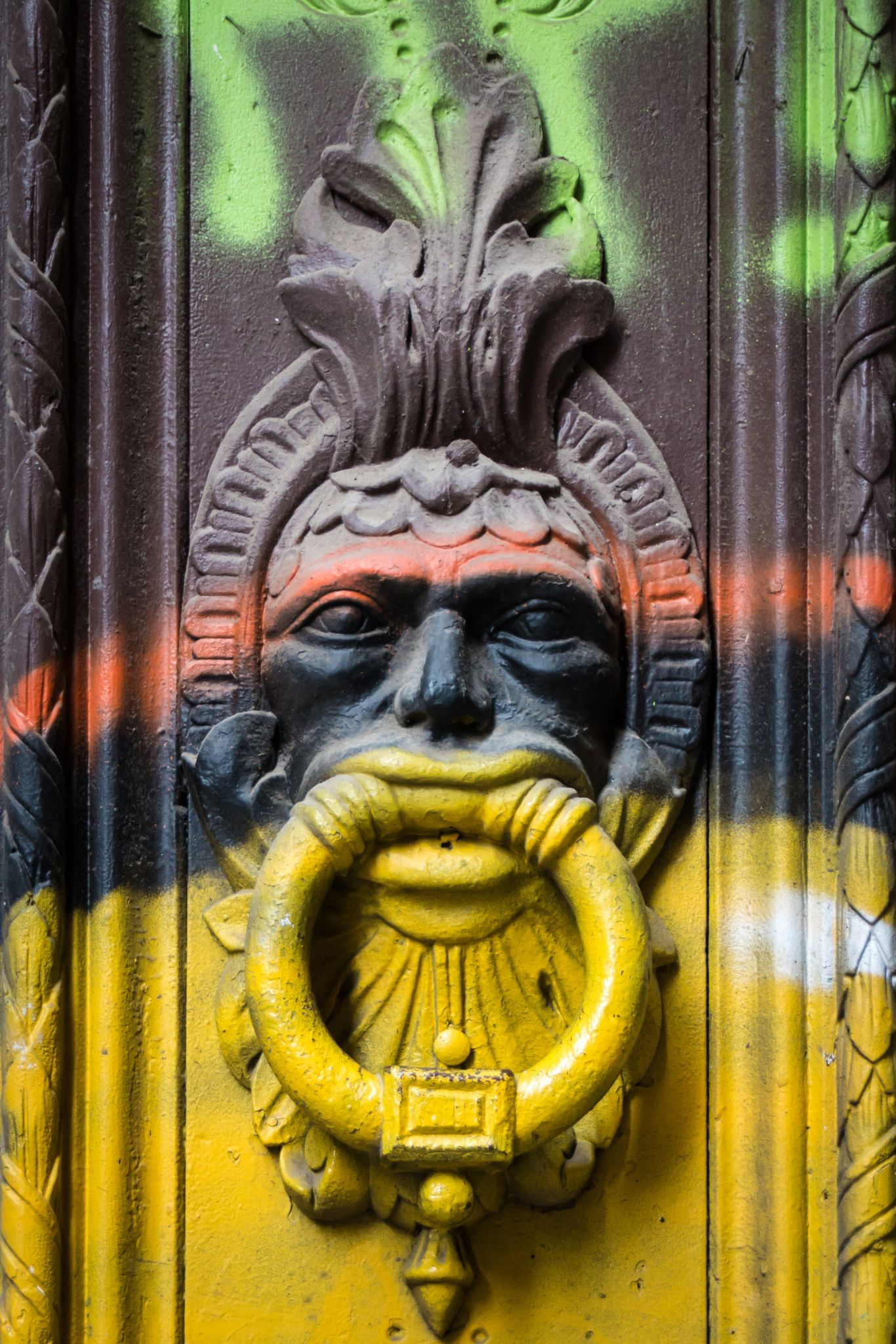 Old Spanish Door Knocker With Graffiti By Irmgard Sabet Wasinger.