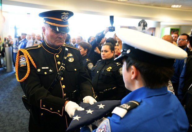 Laxpd Honor Guard Ofc Dye Delivering Us Honor Flag To Tsa Honor Guard Honor Guard Peace Officer Los Angeles Airport