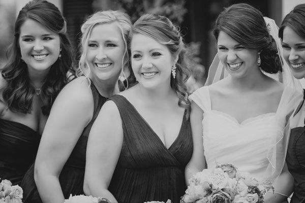 bride smiling with bridesmaids.