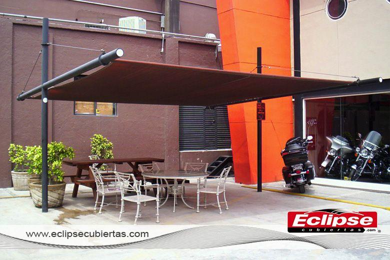 Toldo plano malla sombra ideal para terrazas for Toldos corredizos para terrazas