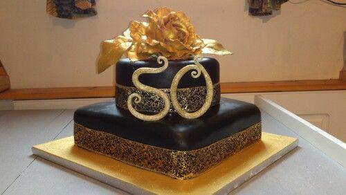 Black and gold 50th cake https://m.facebook.com/Cremedelecake