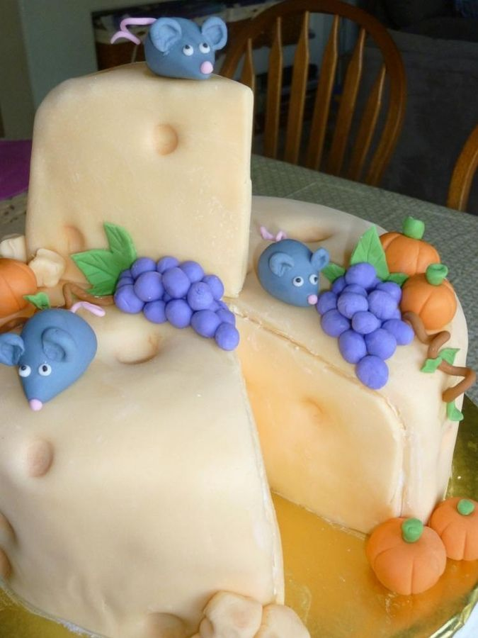 Swiss cheese cake with mice grapes and mini pumpkins Theme