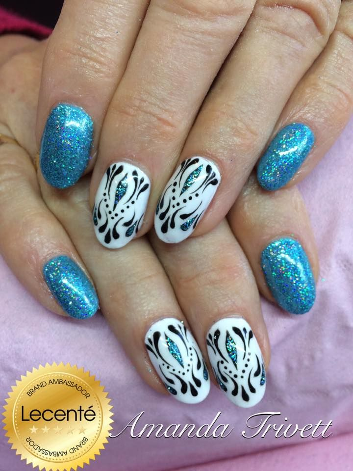 Lecenté Turquoise Holographic Glitter and handpainted design using Lecenté brushes. Nails by Amanda Trivett.