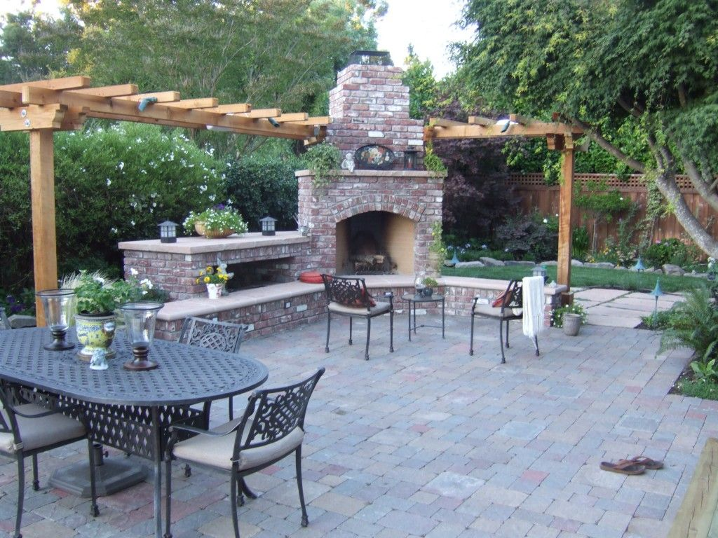 This brick outdoor fireplace adds year round entertainment ... on Brick Outdoor Fireplace Ideas id=70660