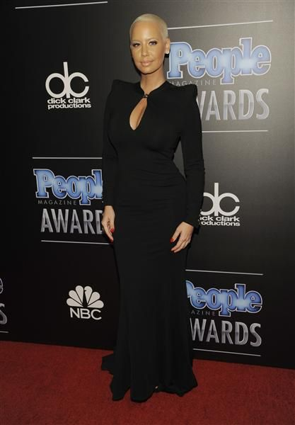 Amber Rose arrives at the 2014 People Magazine Awards at the Beverly Hilton hotel in Beverly Hills, Calif., on Dec. 18, 2014.