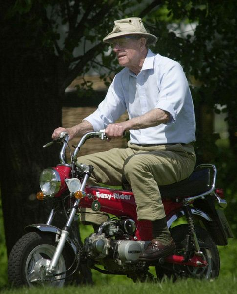Prince Philip Rides A Mini Motorcycle Around The Royal Windsor Horse Show Berkshire