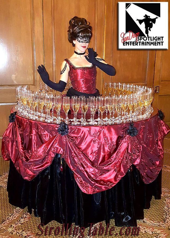 strolling table with champagne on the skirt of her dress