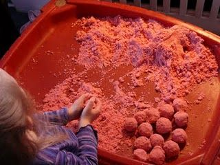 Homemade moon sand - corn starch, colored sand, oil