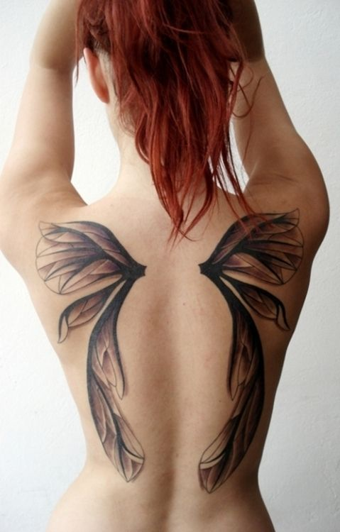 Redhead with butterfly tattoo
