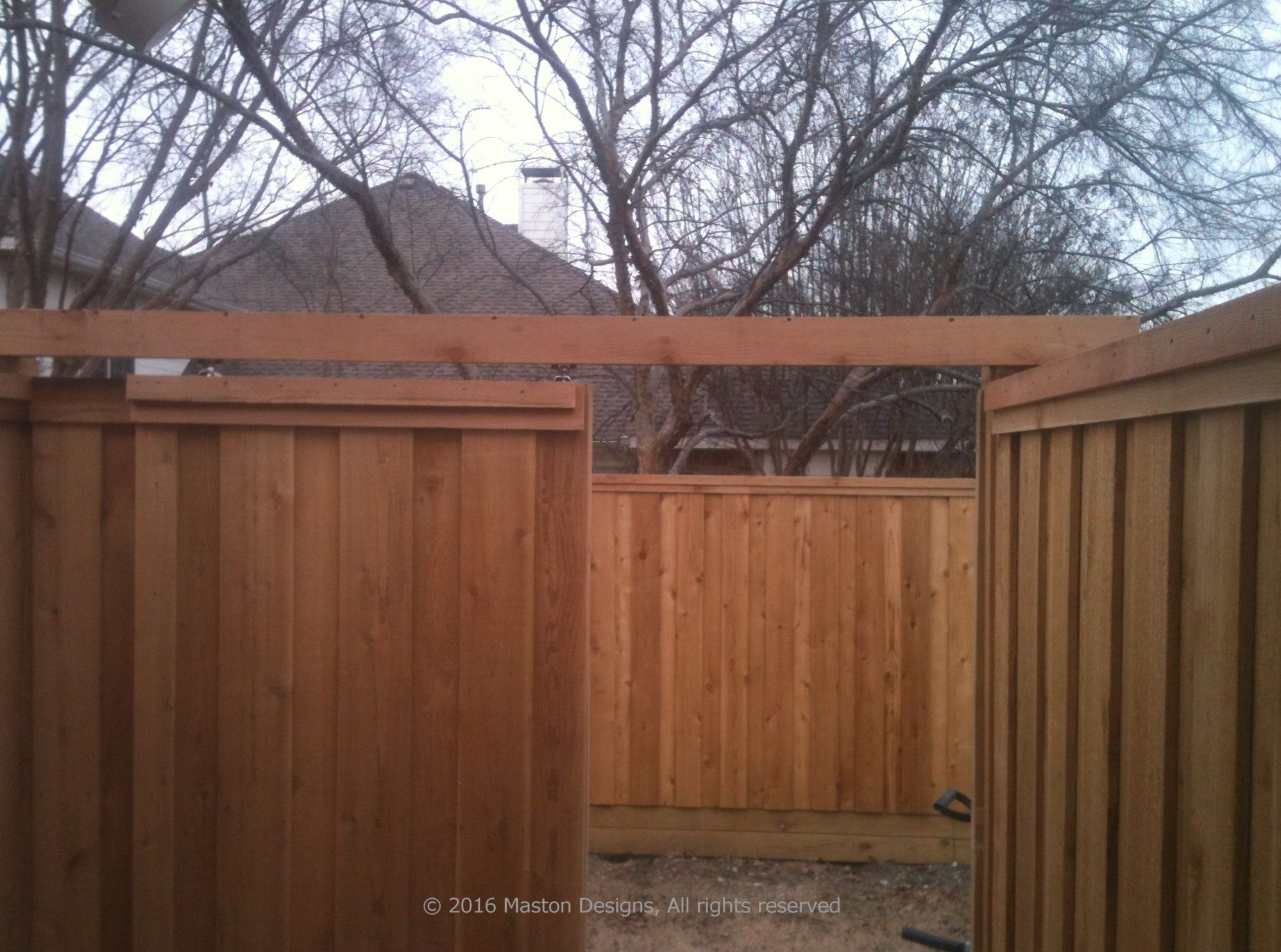 Fence With Inconspicuous Sliding Barn Door Outside View