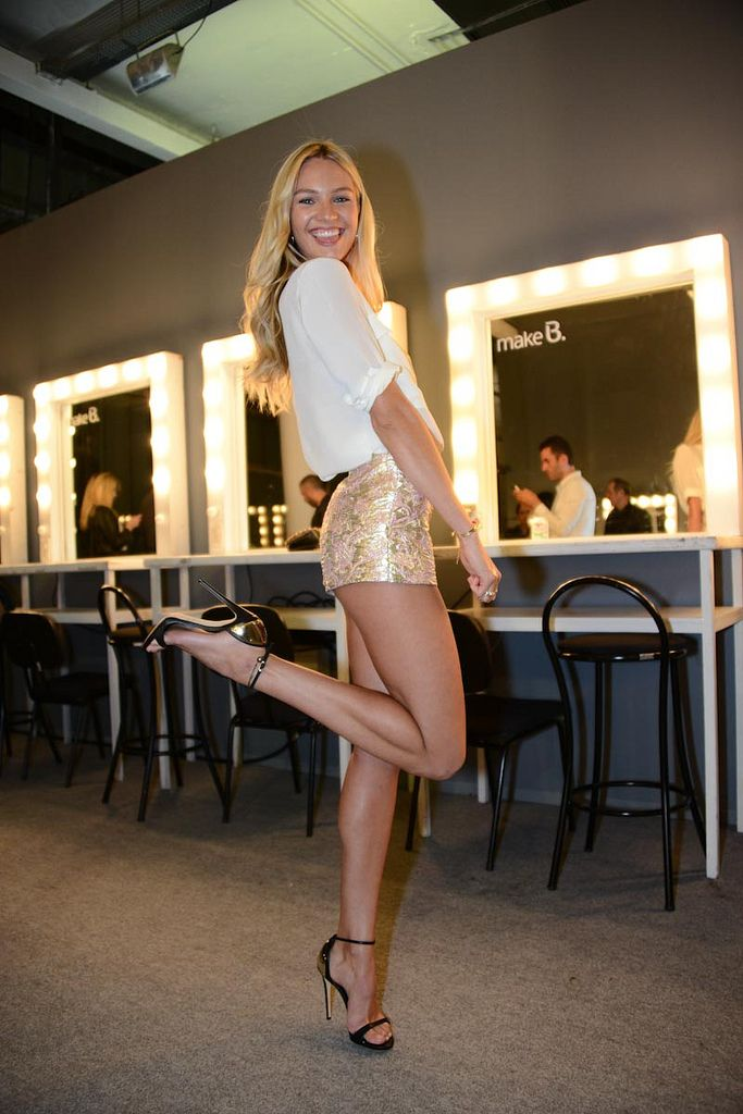 Taylor sexy in short skirt and high heels