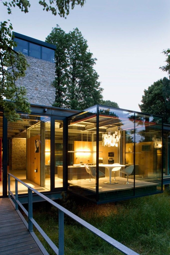 Jodlowa House, a Modern Living Home in Krakow by PCKO. Love steel frame construction. Love cantilevered spaces. Love glass walls.