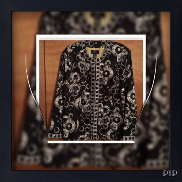 Lovely Black and White Blazer/Jacket Really nice Black and White Blazer/Jacket with beautiful gold lining! It has really nice embellishments around the neckline and all the way down the lapel! The is brand new never worn! Trenz woman  Jackets & Coats Blazers