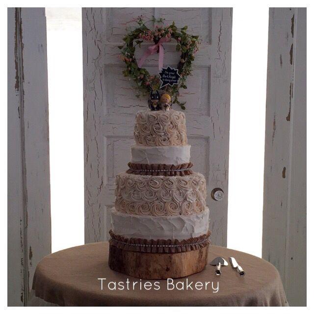 A lovely rustic inspired buttercream rose wedding cake. Bakersfield wedding cakes.