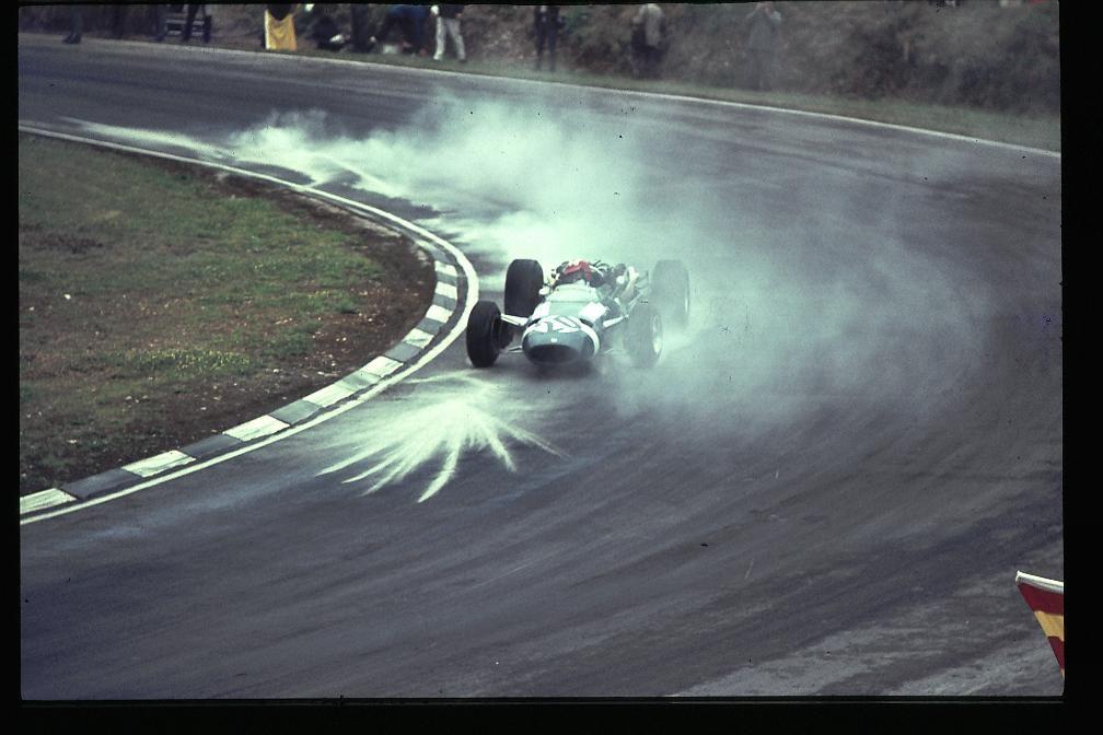 Jo Siffert (Cooper-Maserati) throws up the cement dust at Druids, British GP, Brands Hatch 1966.