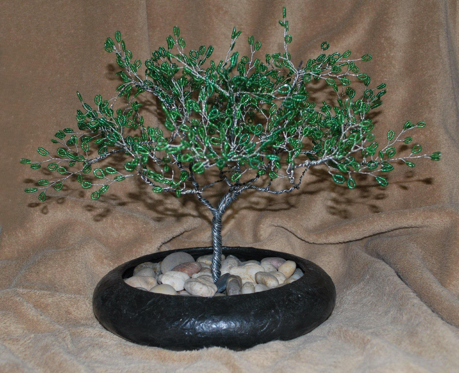 For the tree and branches, I use 20-gauge wire from a roll. For the beaded leaves, I use 26 or 28-gauge wire and seed beads. This is a demonstration of how ...