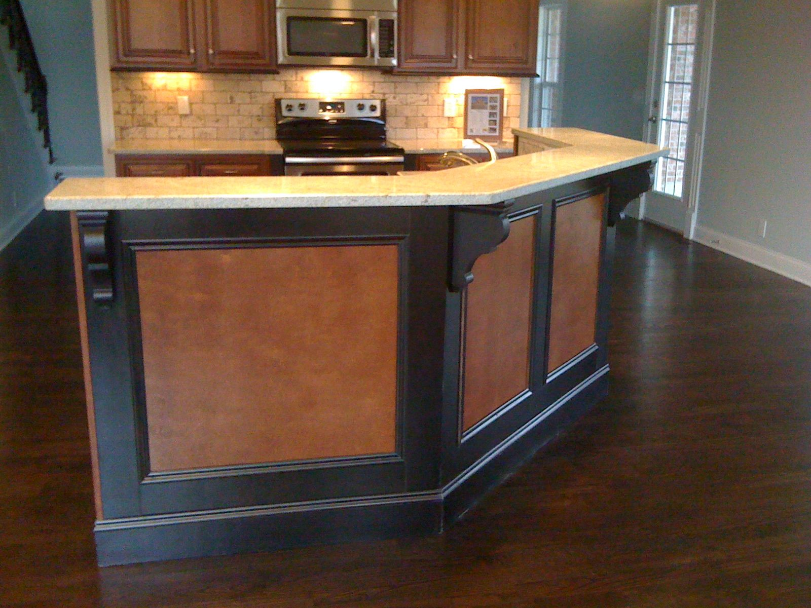 black and brown flat panel lawyer panels on diagonal kitchen island with raised bar top home. Black Bedroom Furniture Sets. Home Design Ideas