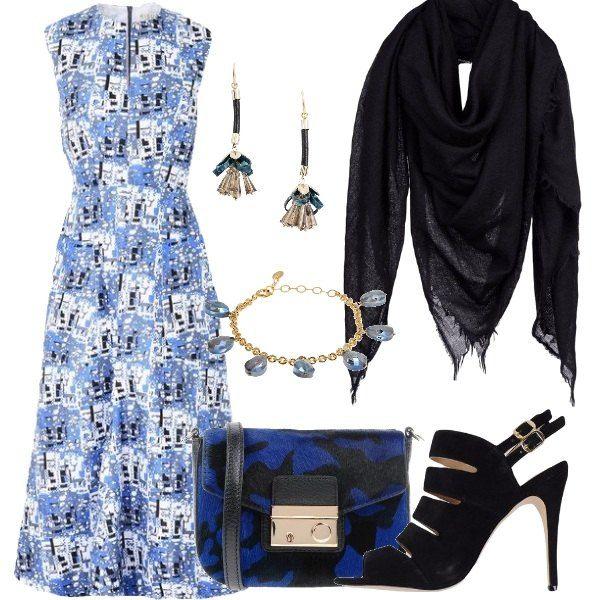 pretty nice 72cb9 93201 Il vestito al polpaccio bianco blu e nero è elegante con gli ...