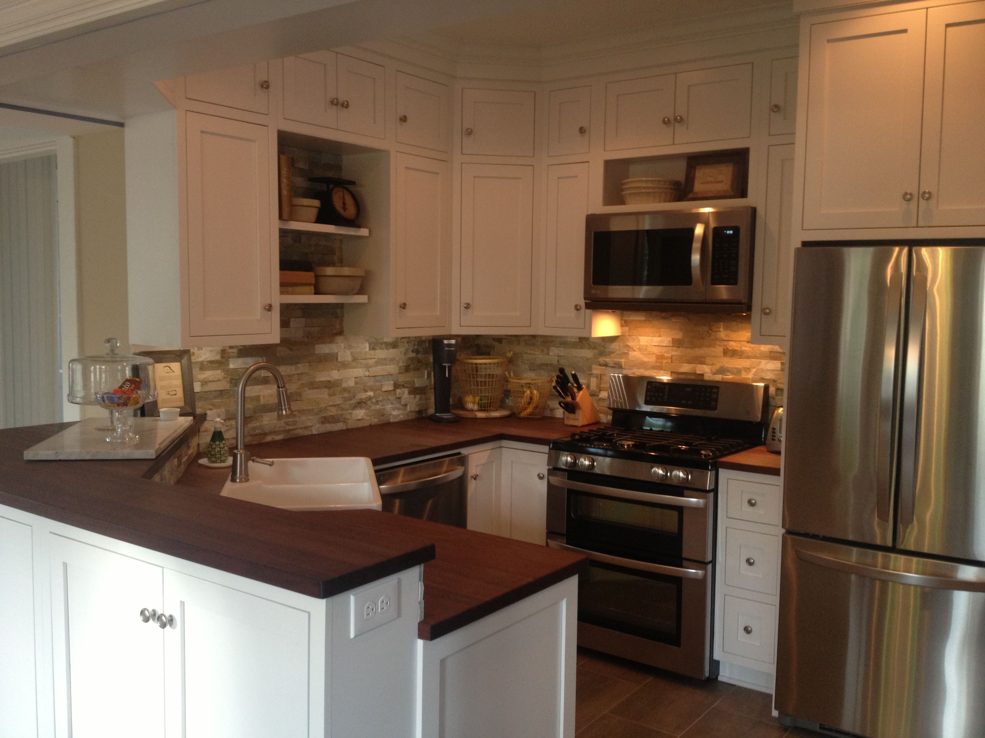 Renovated kitchen! Stone back splash + distressed walnut counter tops