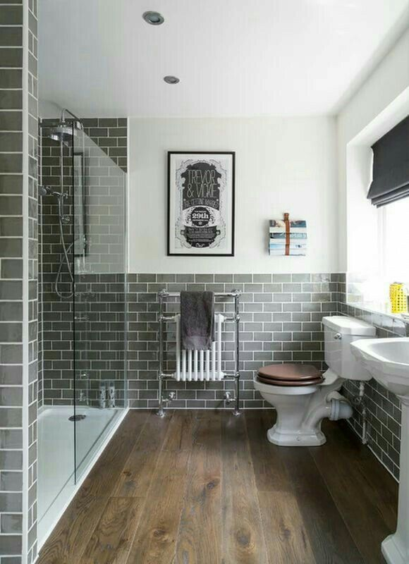 Wood Floor Tile Dark Grey Subway Tile With White Grout White Vanity Small Bathroom Remodel Bathroom Remodel Master Small Master Bathroom