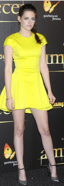 Who made Kristen Stewart's yellow short sleeve dress and black ankle strap pumps that she wore in London on November 15, 2012?
