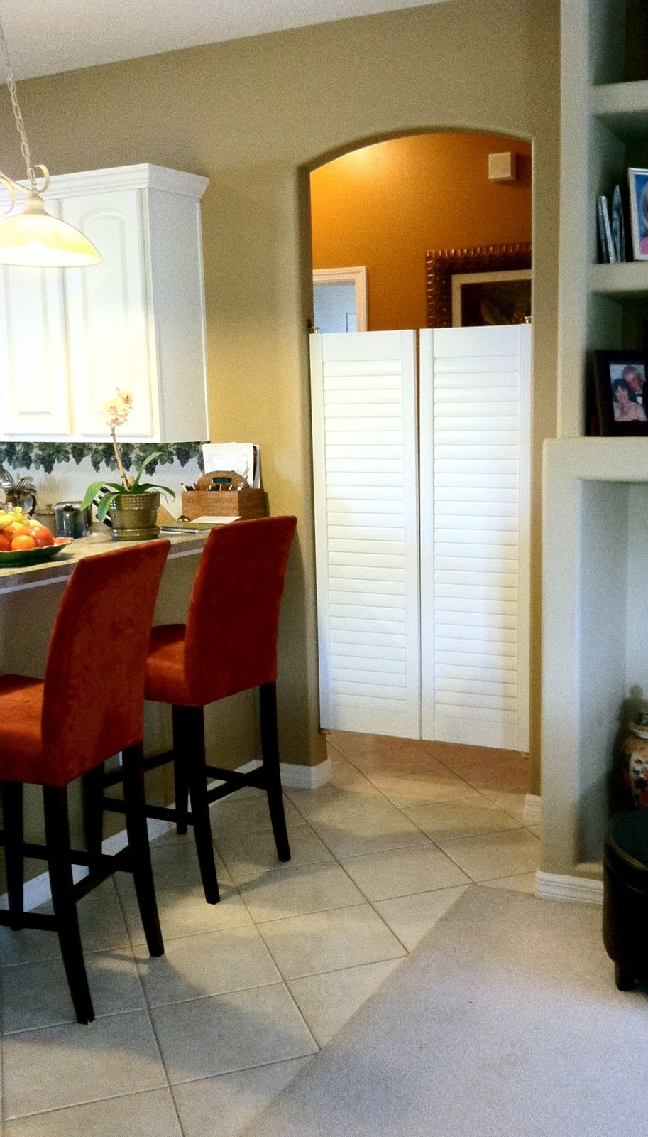 Norman shutters installed as saloon doors beautiful way - Doors to separate kitchen from living room ...