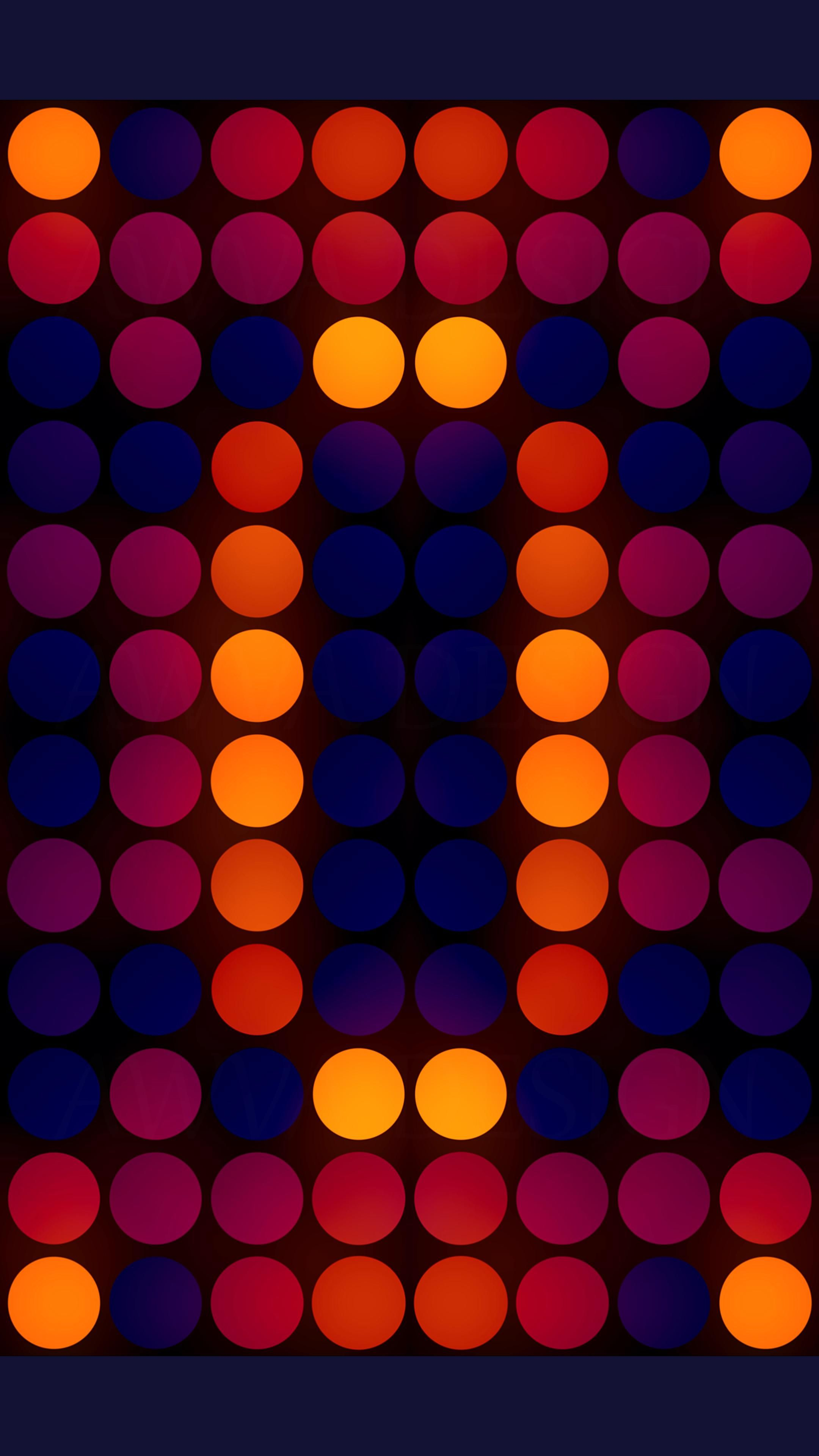 The glowing orange-red kaleidoscope of circles on a dark blue backdrop.
