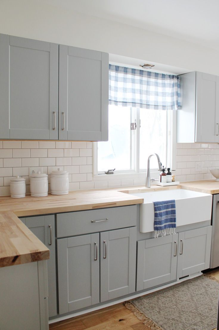 Our small kitchen remodel reveal on a budget with grey cabinets, oak wood floori...