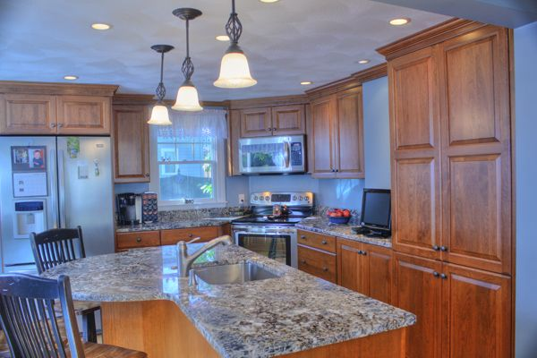 High Quality Blue Flower Granite Kitchen With Wood Contrast.