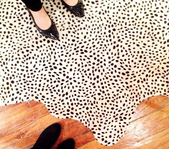 yes a million times to a black and white spotted cowhide rug in an otherwise white