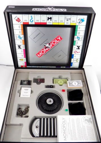 Monopoly onyx edition board game good used condition complete in.