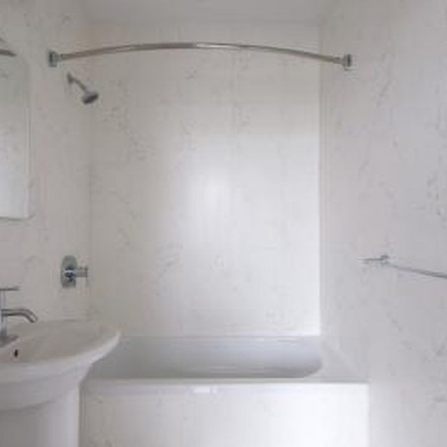 Paint the plastic tub insert to create a new look for the bathroom ...