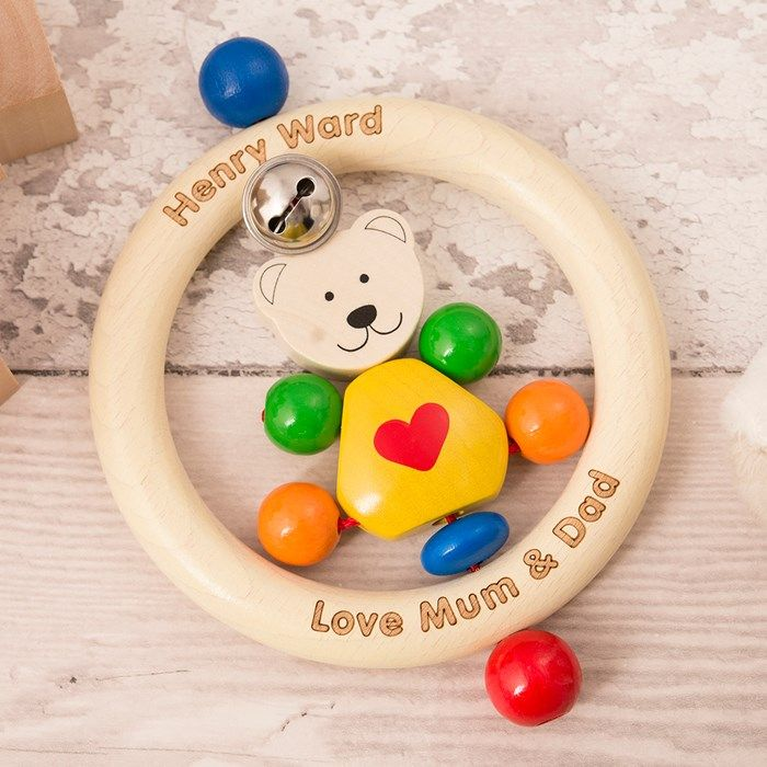 Shaped like a teddy bear with a friendly face, this rattle is sure to delight your child and keep them smiling! It can be engraved with a name of your choice. Shop now!
