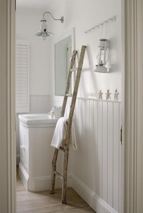 Web Image Gallery White cottage bathroom features upper walls painted white and lower walls clad in beadboard trim lined