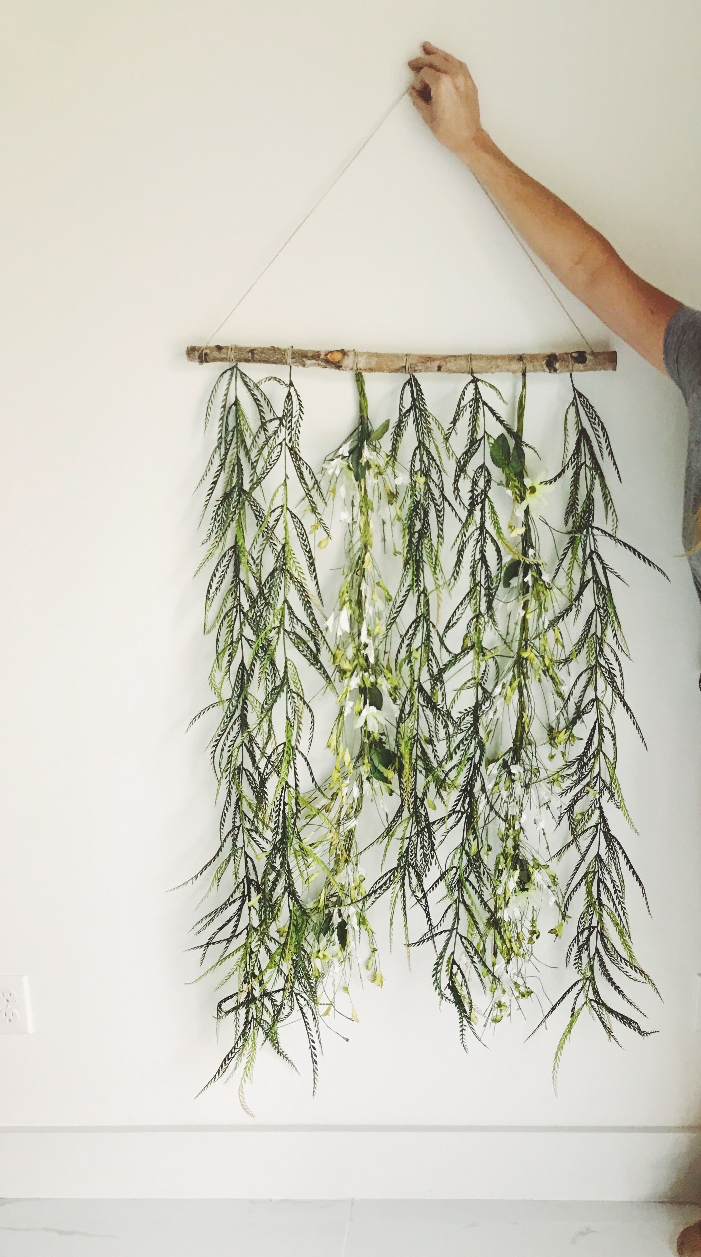 Easy Dyi Decoration Of Greenery And Flowers Hanging Off A Branch On A Wall All Supplies From A Craft Sto Greenery Wall Decor Greenery Decor Wall Decor Bedroom