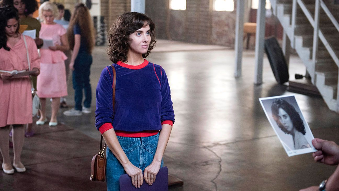 Alison brie steps into the ring in first look at jenji
