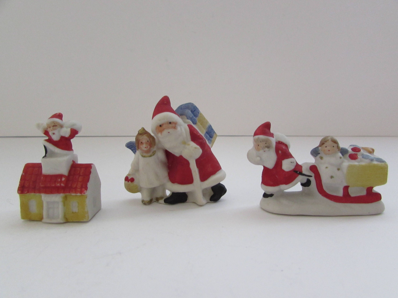 Christmas Miniatures.Three Miniature Christmas Santa Claus Figurines Germany