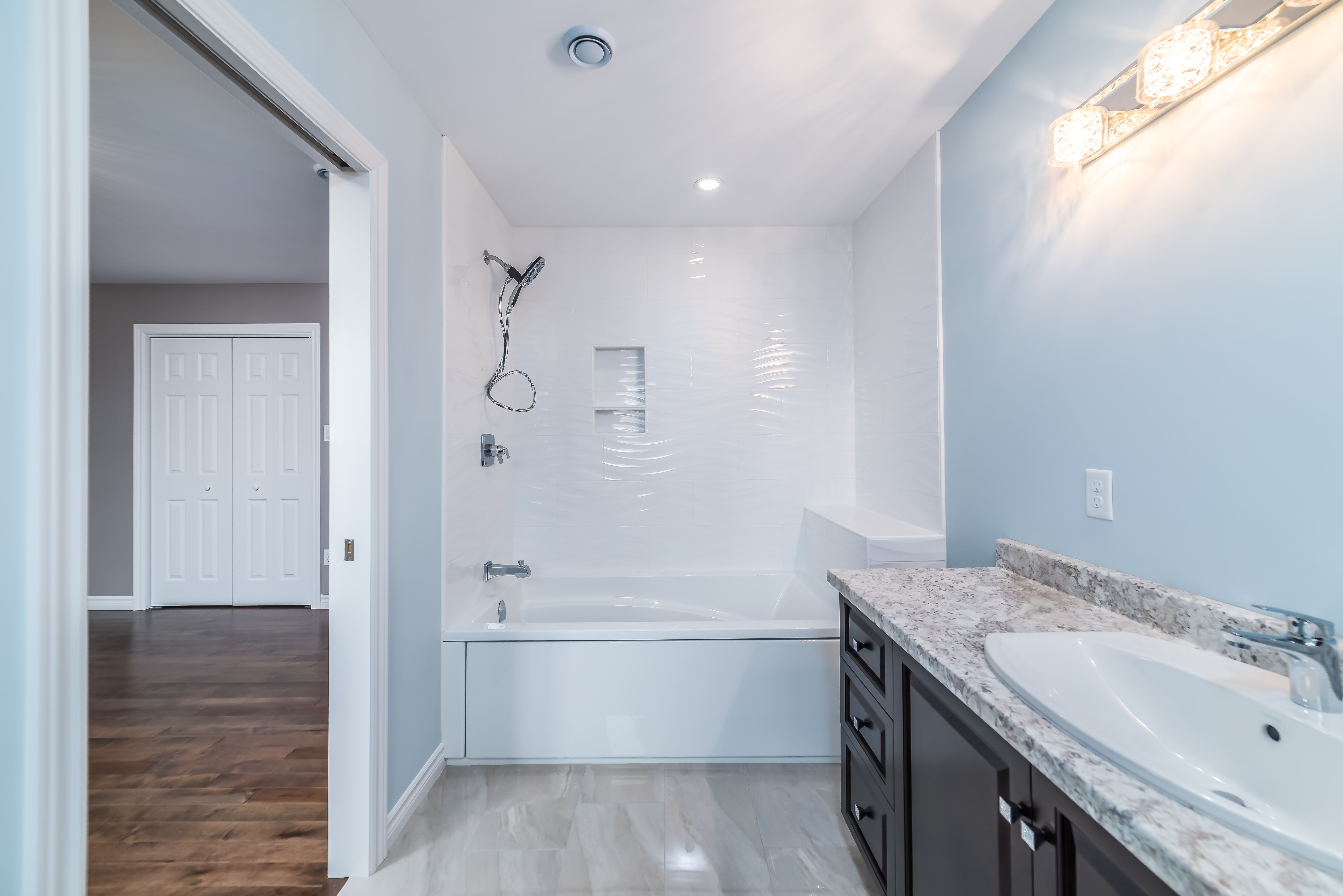 A customized ensuite bathroom in our Raleigh design ...