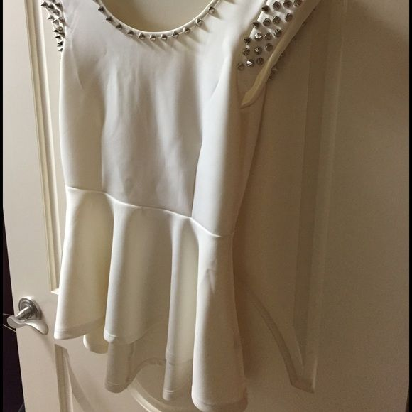 Romeo and Juliet couture Peplum top Brand new with tags. Size M. Beautiful studded details Romeo & Juliet Couture Tops Blouses