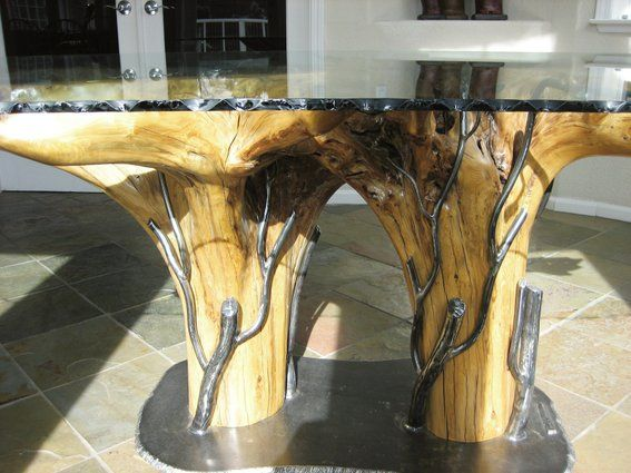 Cedar Stump And Wrought Iron Dining Table With A Bark Edged Glass