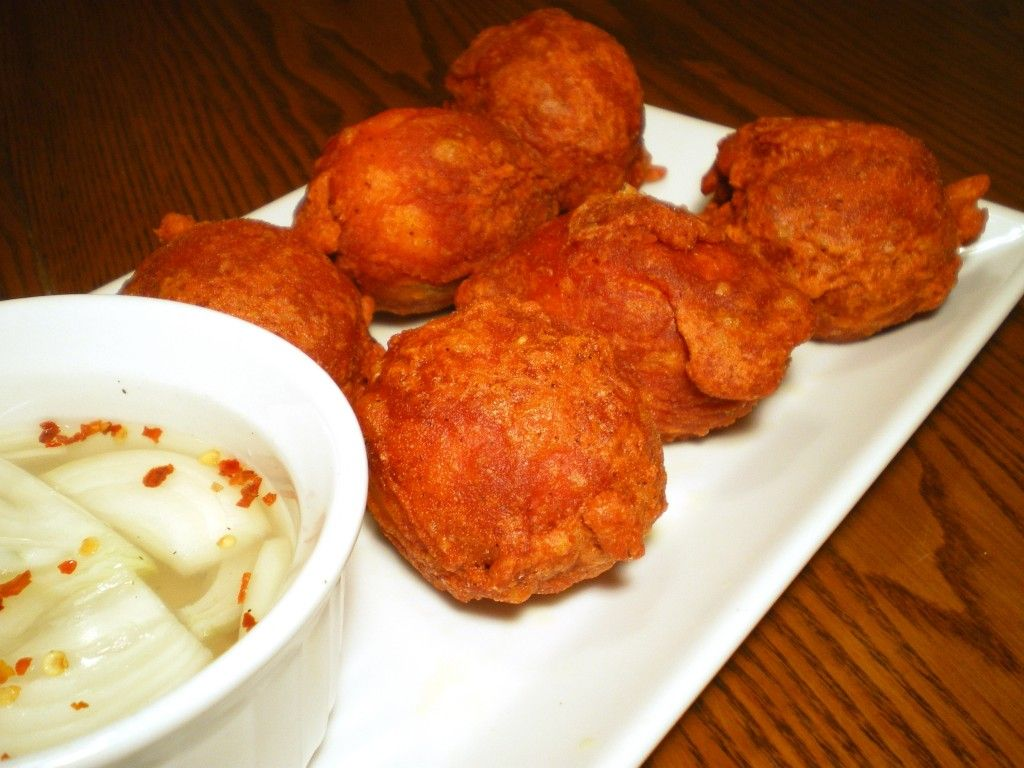 Filipino Tokneneng - boiled eggs fried coated with annatto batter and deep fried. A popular street food.