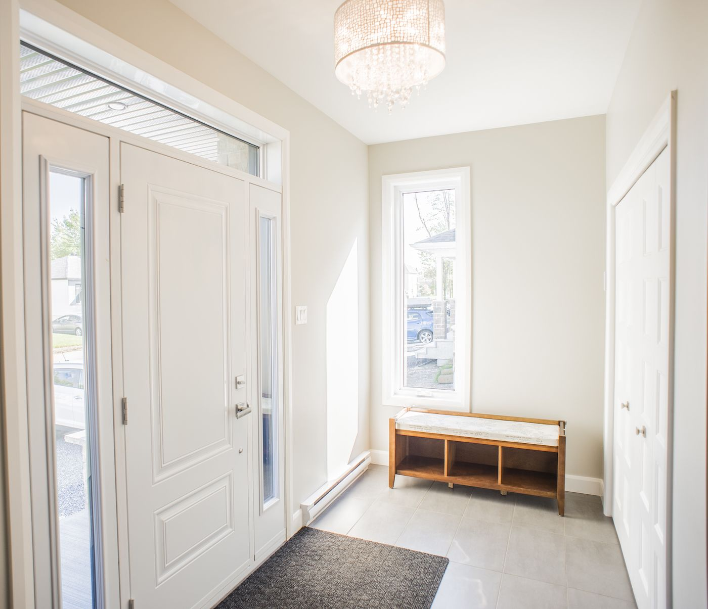 Large windowed door. White trim and white doors as accents. & Spacious main entry. Large windowed door. White trim and white doors ...