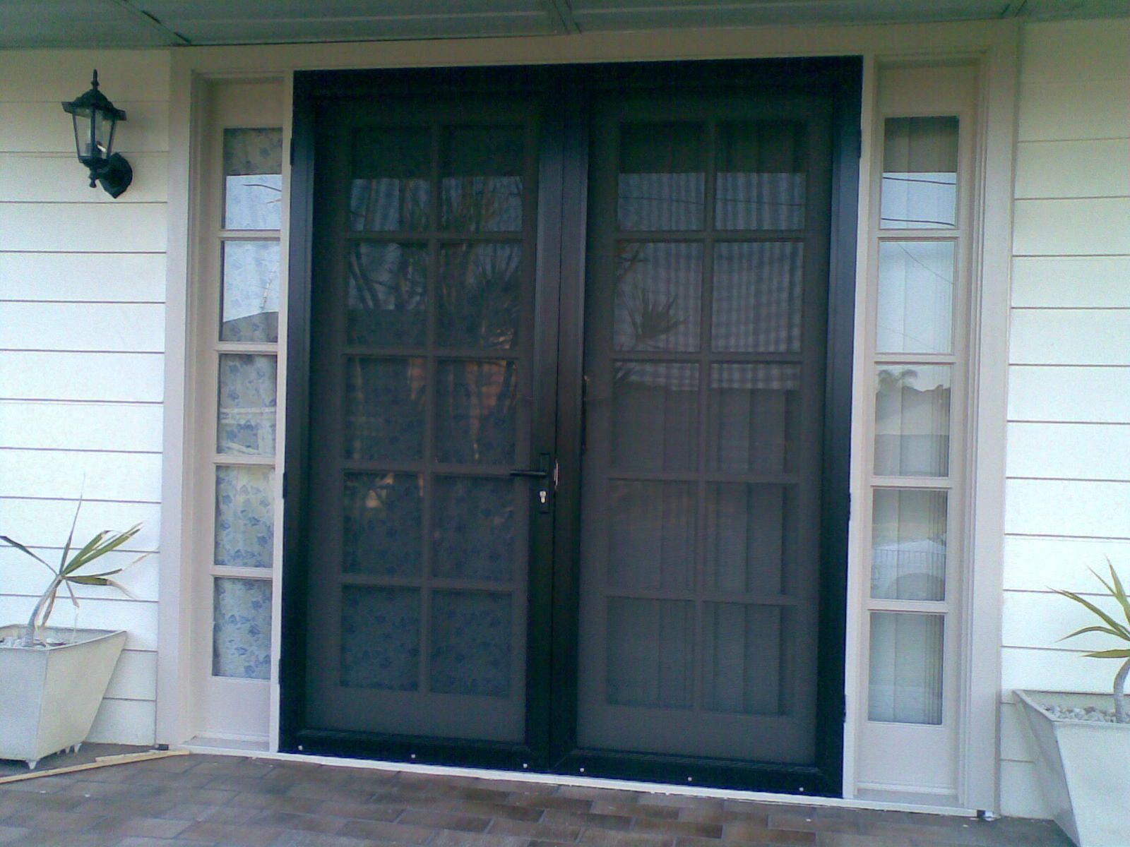 Interior Appealing Security Screen Doors With Double Vase And